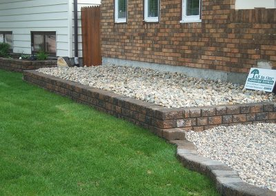 tiered flowerbed and stone
