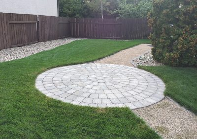 landscaped yard with circular patio