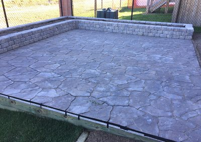 stone patio and surrounding flowerbed
