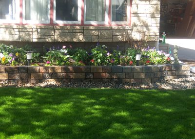 flowerbed with stone trim